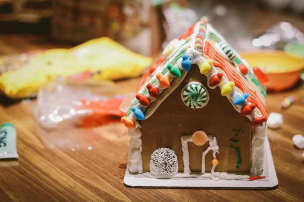 one of the best activities to do in December with kids is to make a gingerbread house